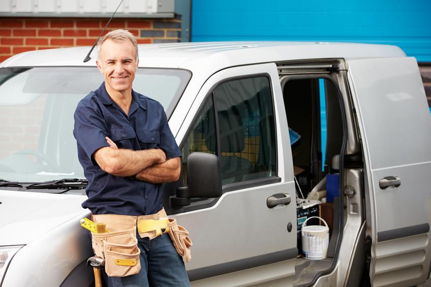 Plumber Or Electrician Standing Next To Van
