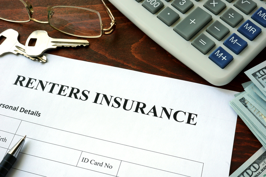 Renters insurance application form and dollars on the table.