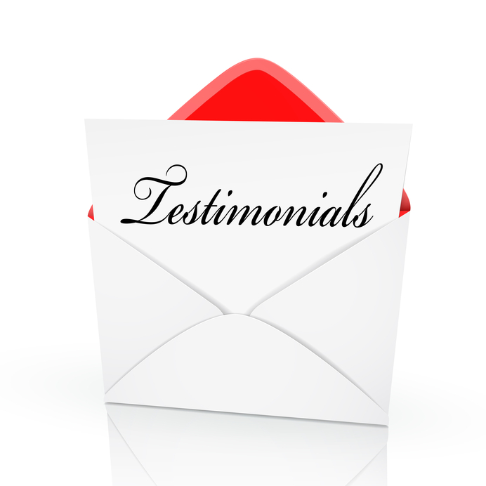 the word testimonials on a card in an envelope